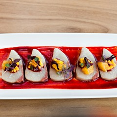 Yellowtail in a sauce of guajillo chile and hibiscus flower, with mango relish garnish at Leña Brava