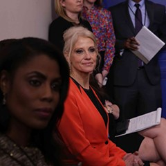 """Senior White House adviser Kellyanne Conway, center listens to press secretary Sean Spicer during a daily briefing. She later defended Spicer by saying he had offered the press """"alternative facts."""""""