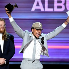 Chance the Rapper accepts the Best Rap Album award for Coloring Book onstage during the Grammy Awards Sunday night.