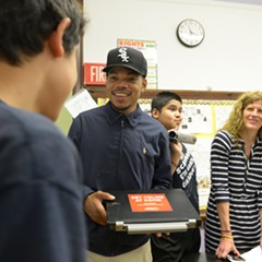 Chance the Rapper meets with students from west-side Scammon Elementary School in May 2015.