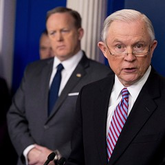 Attorney General Jeff Sessions, accompanied by White House press secretary Sean Spicer, talks to the media at the White House Monday.