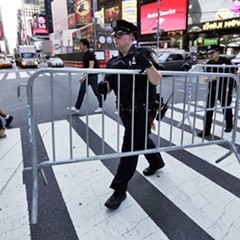 Following a vehicle attack in May, New York City police installed metal fences and concrete barriers along blocks of Times Square.