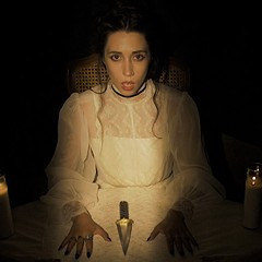 Jessica Marks sings a ghostly song in a haunted house