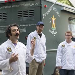 Michael Rakowitz speaks during an October 1 activation of Enemy Kitchen outside the MCA.