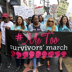 Participants march against sexual assault and harassment at the #MeToo March in Hollywood on November 12.