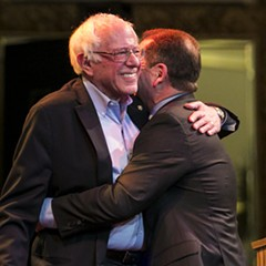 Bernie Sanders embraces Chuy García at a rally in Little Village on Thursday.