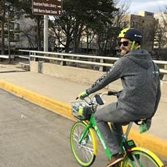 Will Piper, of LimeBike, pedals through Rockford.