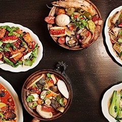 """Some of the great dishes at Fat Rice (clockwise from top middle): arroz gordo (""""fat rice""""), Fat Rice noodle, bok choy with pork stock, balichang catfish, African chicken, and shaking chile whitefish"""