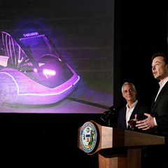 Mayor Rahm Emanuel listens to Tesla CEO and Boring Company founder Elon Musk at a press conference last week.