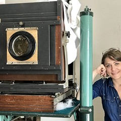 "Jen Jansen with ""the Beast,"" a Deardorff 11x14 studio camera from the 20s, made in Chicago"
