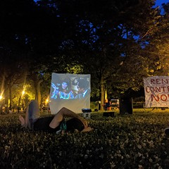 A recent outdoor screening of The Spook Who Sat by the Door at a tent city demonstration