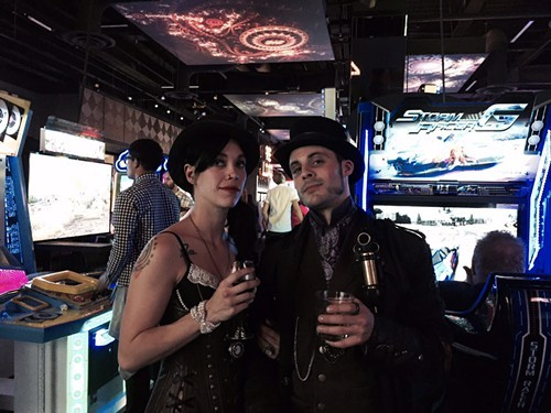 Joseph Vourteque (right) and fellow steampunk circus performer mingle shortly before their performance.