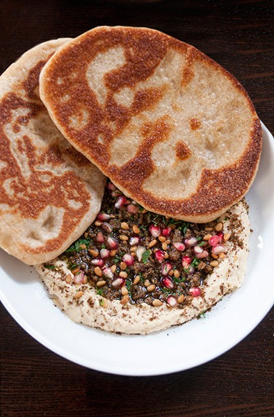 "One dish you shouldn't miss: ""lamb hashwi,"" served with flatbread"
