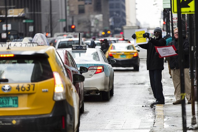 Chicago taxi drivers demonstrated outside City Hall and circled neighboring streets to protest the granting of a city license to rideshare company Uber in February. - (FLICKR/SCOTT L.)
