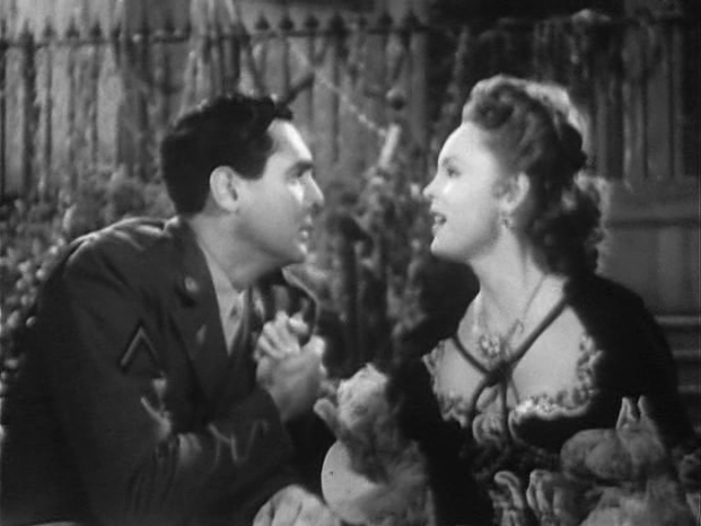 Phillip Reed and Nancy Coleman in Her Sister's Secret