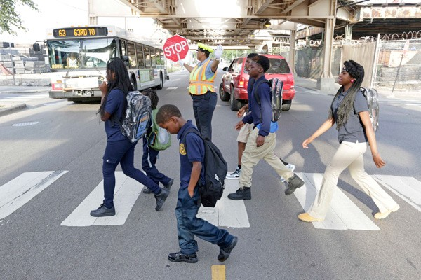 Children cross 63rd Street on their way to school. Northwestern University sociologist Mary Pattillo argues that many south-side parents and guardians lack real school choice, even with charters. - M. SPENCER GREEN/AP PHOTO