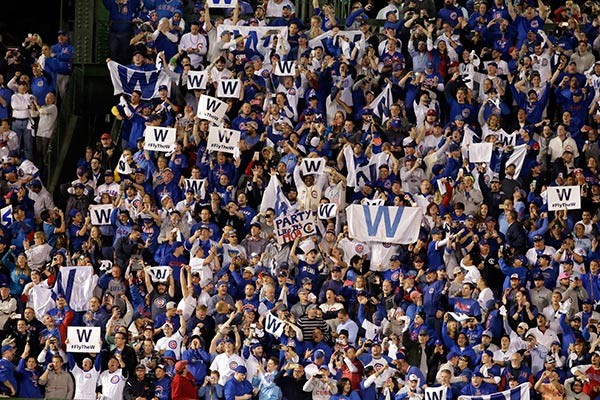 Cubs fans cheer after game four of the National League Division Series. Doesn't this seem like a distant memory? - AP PHOTO/NAM Y. HUH