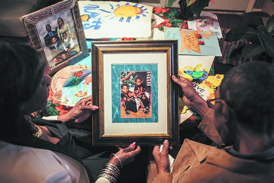 Danelene Powell and Steven Watts Sr. hold a photo of their son Stephon, right, as a young child. Also pictured is another son, Steven Jr. - JEFFREY MARINI