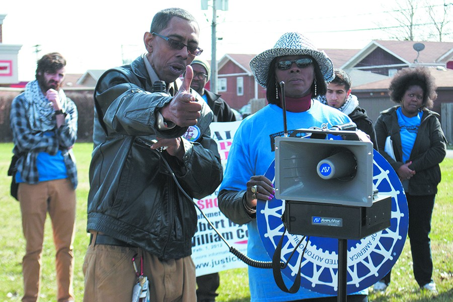 Watts, pictured with Powell at an April rally, mimics what he saw when police drew their guns on Stephon. - ADRIENNE HURST