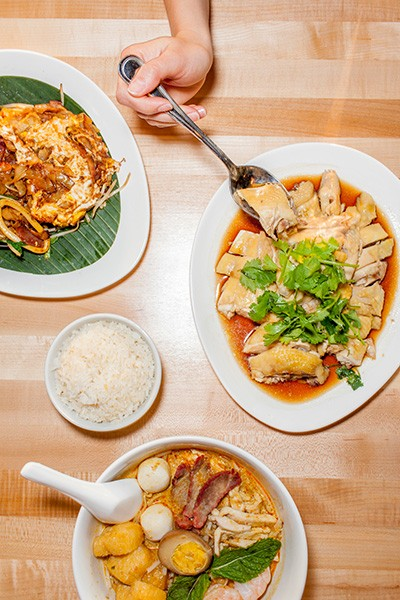 Clockwise from top left: char koay teow, Hainanese chicken, curry laksa