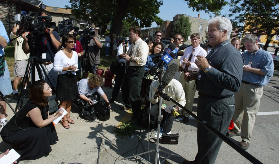 Camden, pictured in 2003 during his time as a CPD spokesman, has often been the only voice of authority talking to reporters immediately after a police shooting. - TIM BOYLE/GETTY IMAGES