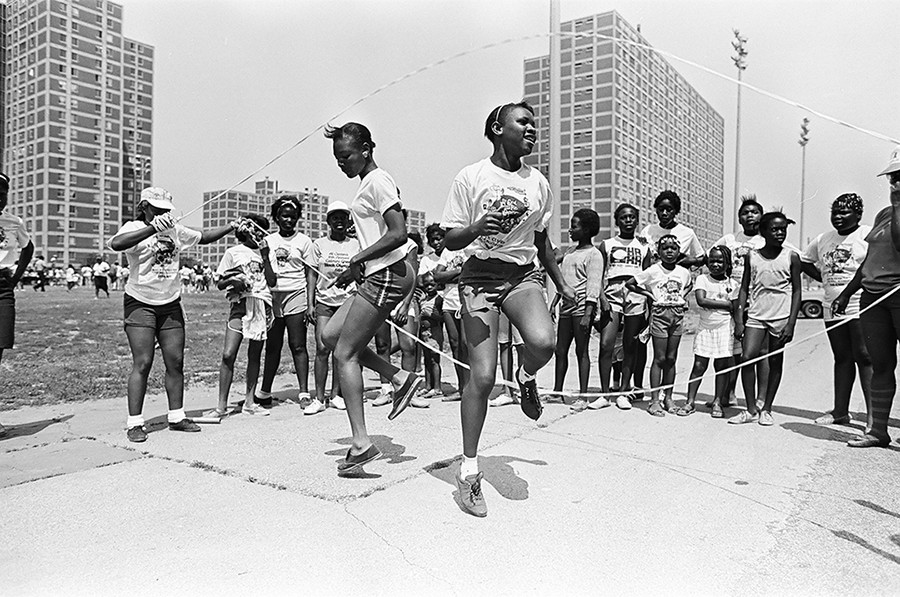 Two girls play double Dutch outside the Cabrini-Green housing development in July of 1984. - SUN-TIMES NEGATIVE COLLECTION