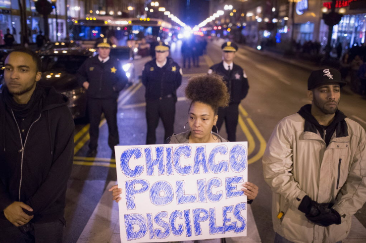 Demonstrators march through downtown on December 11, 2015. - SCOTT OLSON/GETTY IMAGES