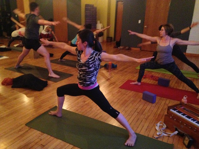 "Sara Strother posing during ""Living Loving Yoga"" - JOHN GREENFIELD"