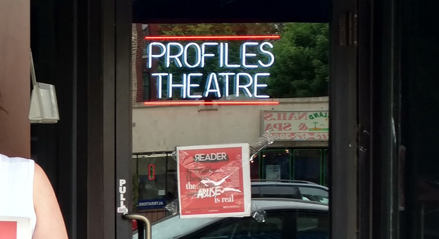 Protesters taped a copy of the Reader to the front of Profiles Theatre Thursday morning. - EILEEN TULL