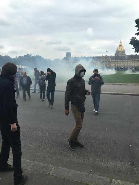French police shoot tear gas and high-powered water cannons at labor protesters. - RYAN SMITH