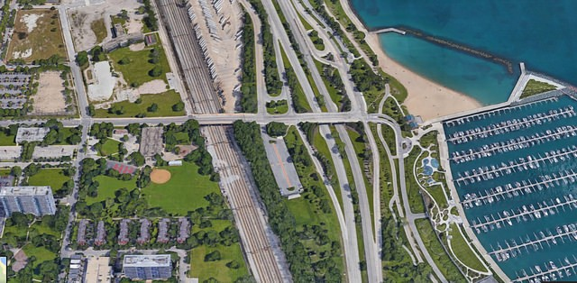 An aerial view of 31st Street Beach. The Park District plan proposes adding spots to the west lot, center. - GOOGLE MAPS