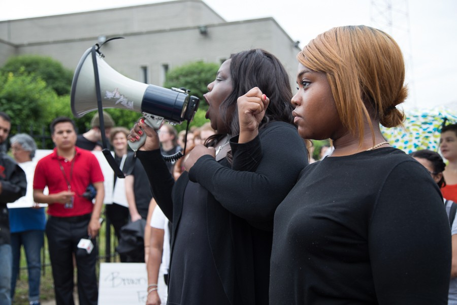 Protest organizers Imani, left, and Kristen gave safety instructions before the march, showing how to lock arms so that the police could not easily break the group apart. - SUNSHINE TUCKER