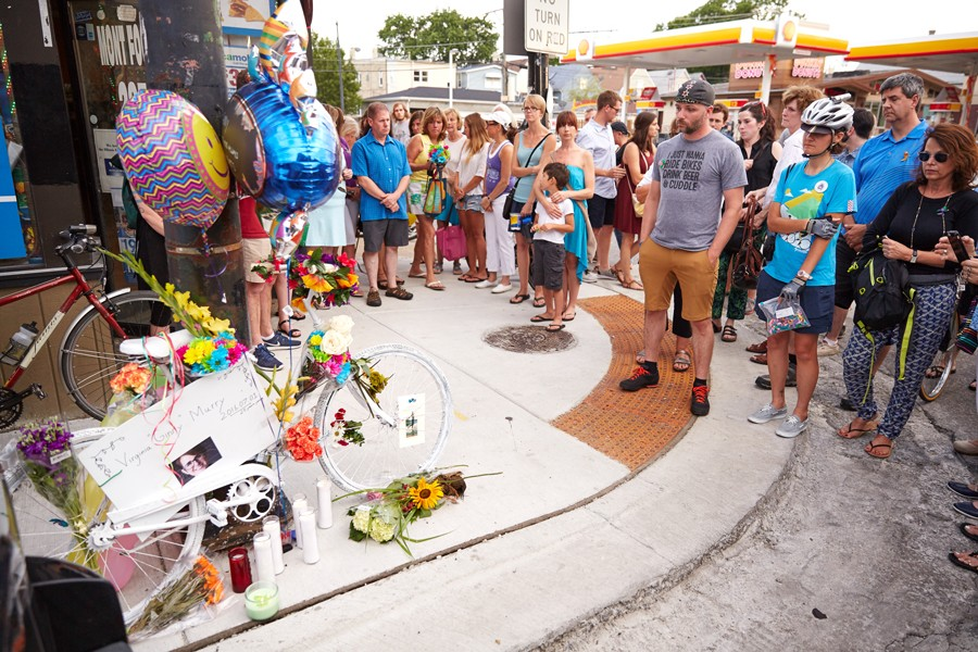 A memorial for Virginia Murray was held on July 10 at the Avondale corner where, while riding a Divvy bike, she was struck and killed by a truck driver. Anthony Arce, right, helped organize the event. - DONTE TATUM