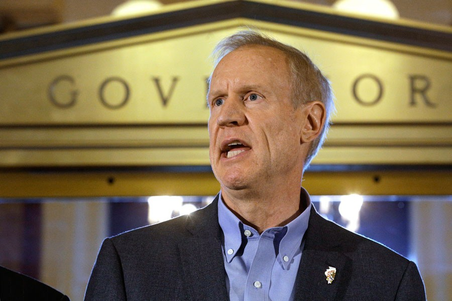 Governor Bruce Rauner after stopgap budget was passed. - SETH PERLMAN/AP PHOTO