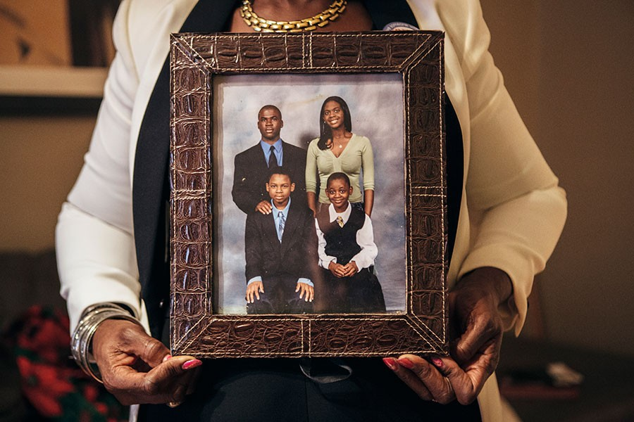 Danelene Powell holds a photo of her children, including Stephon Watts, bottom right. - JEFFREY MARINI