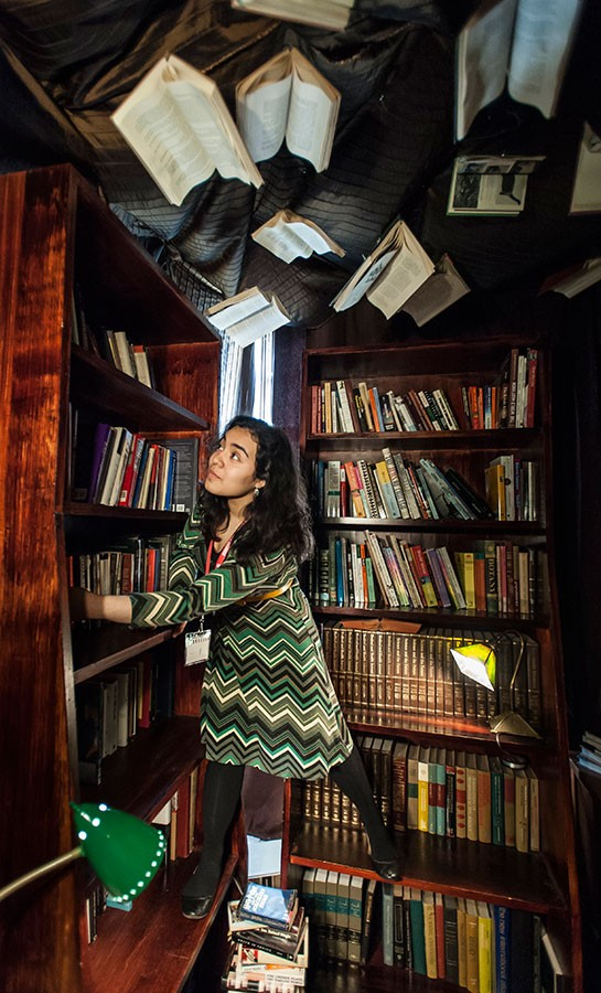 Actress Maria Velazquez in the library of Ellen Gates Starr High School, an instance of heightened reality on the set of Learning Curve