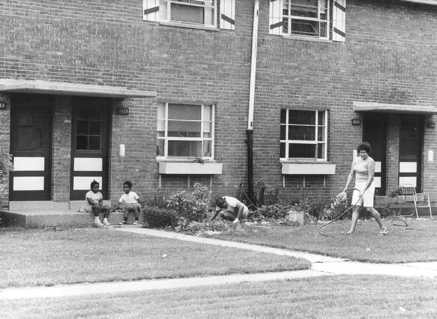 Tenants work on the flower garden outside a LeClaire Courts apartment in 1975. - HOWARD D. SIMMONS/SUN-TIMES ARCHIVE