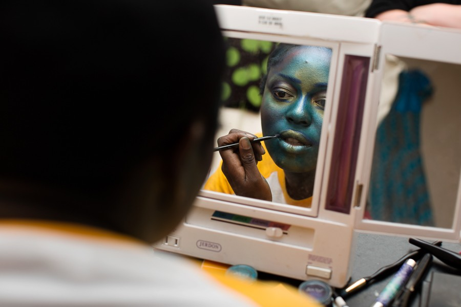 """Ebijimi applies a mask of iridescent makeup, including a line of dark blue around her lips to make them pop during her lip-sync routine. """"It's easier for me to do colorful faces,"""" she says. - SUNSHINE TUCKER"""