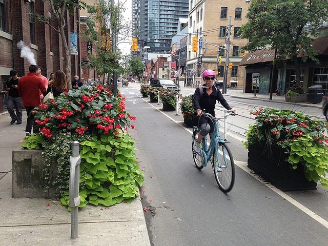 Colorful planters add beauty—and protection—to a bike lane on Adelaide Street. - JOHN GREENFIELD