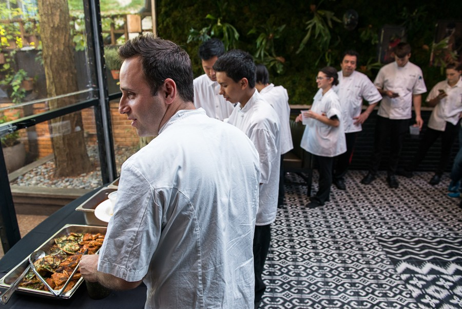 Chef Lee Wolen queues up for a Korean feast from sous chef Eddie Lee. - JAMIE RAMSAY