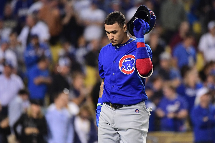 Javier Baez strikes out during the Cubs' loss to the Dodgers on October 18. - HARRY HOW/GETTY