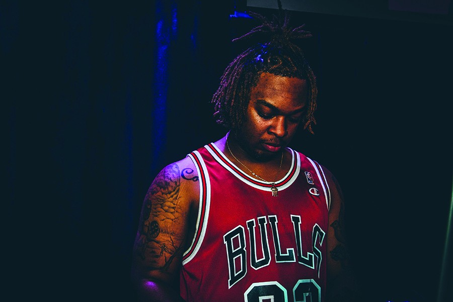 Nick Watts, who tours with Dreezy as DJ Hoop Dreams, credits radio with getting Chicago artists broader recognition—but he'd still like to see programming devoted entirely to locals. - J VISUALS