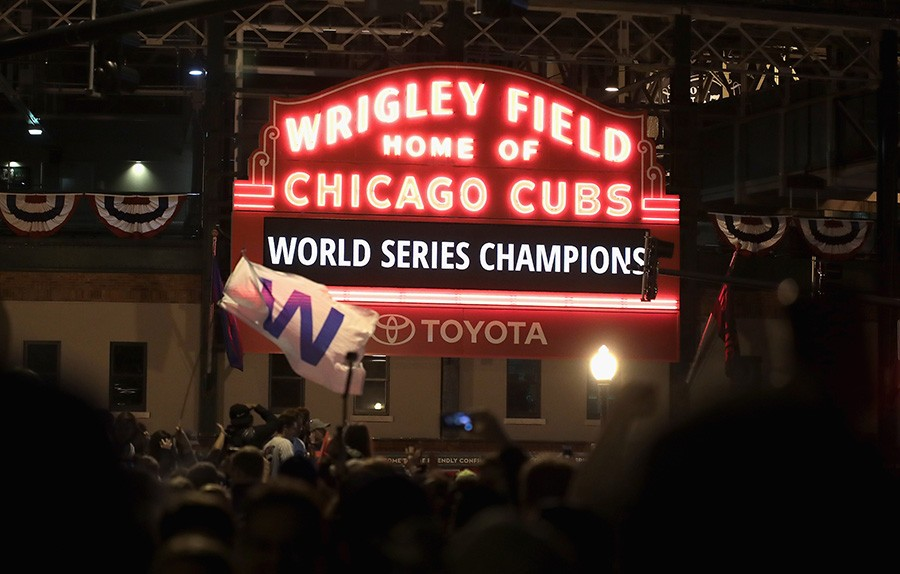 Cubs fans celebrated outside Wrigley Field early Thursday morning. IS THIS LIFE??? - SCOTT OLSON