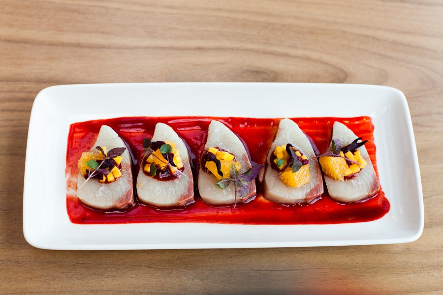 Yellowtail in a sauce of guajillo chile and hibiscus flower, with mango relish garnish at Leña Brava - DANIELLE A. SCRUGGS