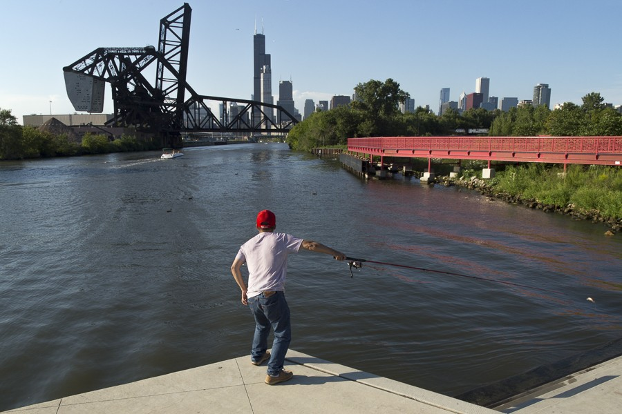 Taken on August 19, 2016 in Ping Tom Park, a man casts his rod while fishing from the south branch of the Chicago River.