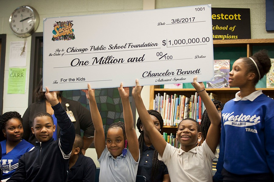 Beaming Westcott Elementary School students hold up the check from Chance. - ASHLEE REZIN/SUN-TIMES