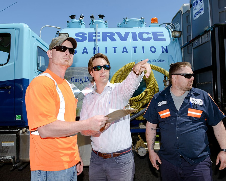 Service Sanitation senior account manager Keith Kay (center) with colleagues Jeffery Matthews and Jon Mosley - MATTHEW AVIGNONE