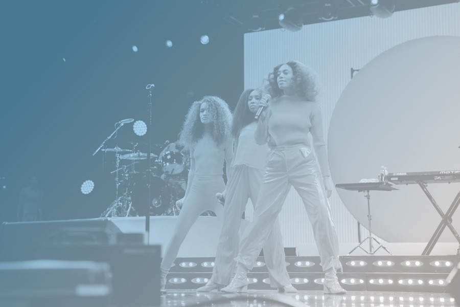 Solange Knowles (far right) performs at the 2017 Essence Festival in New Orleans. - BENNETT RAGLIN/GETTY IMAGES FOR 2017 ESSENCE FESTIVAL
