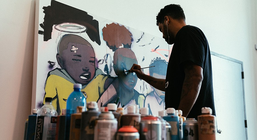 Hebru Brantley works in his studio. - MAX SCHREIER