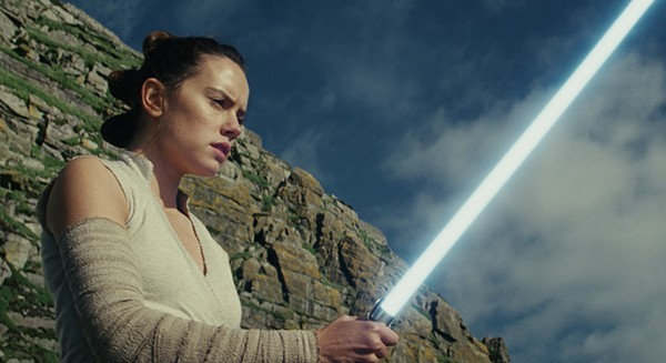 Daisy Ridley swings a real-deal lightsaber in Star Wars: The Last Jedi.
